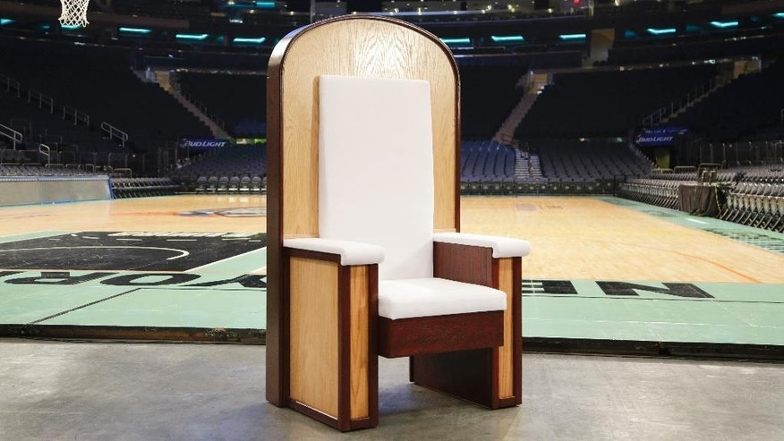 The Pope's chair is unveiled during a media event at New York's Madison Square Garden, Wednesday, Sept. 2, 2015. The simple wooden chair has been built for Pope Francis when he celebrates Mass at the sports and entertainment arena on Friday, Sept. 25. (AP Photo/Mark Lennihan)