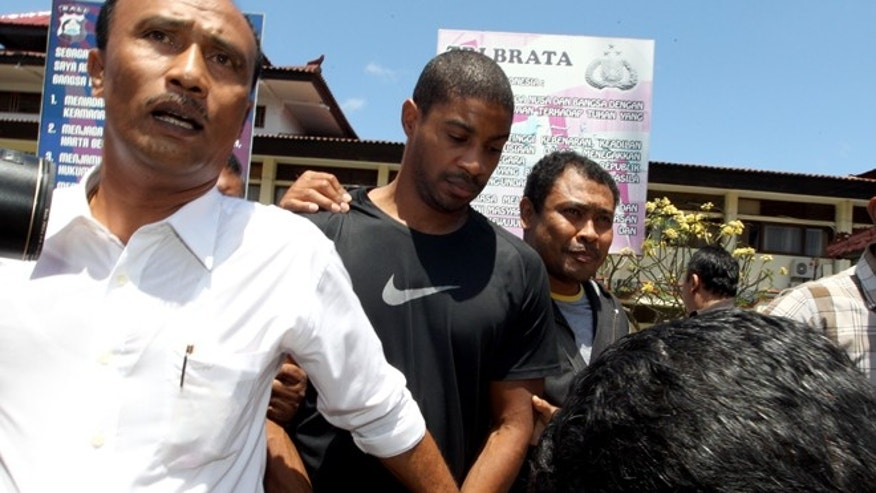 Sept. 2, 2015: Former Austin,Texas, police officer VonTrey Jamal Clark, center, is escorted by Indonesian police officers during his extradition in connection with a murder case at the regional police headquarters in Bali, Indonesia.