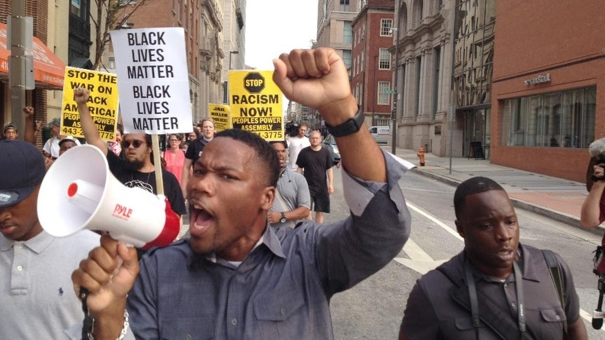 "Pastor Westley West, from Faith Empowered Ministries, leads protesters as they march towards Pratt Street and the Inner Harbor, Wednesday, Sept. 2, 2015, in Baltimore, as the first court hearing was set to begin in the case of six police officers criminally charged in the death of Freddie Gray.   Six police officers face charges that range from second-degree assault, a misdemeanor, to second-degree ""depraved-heart"" murder.   (Lloyd Fox/The Baltimore Sun via AP)  WASHINGTON EXAMINER OUT; MANDATORY CREDIT"