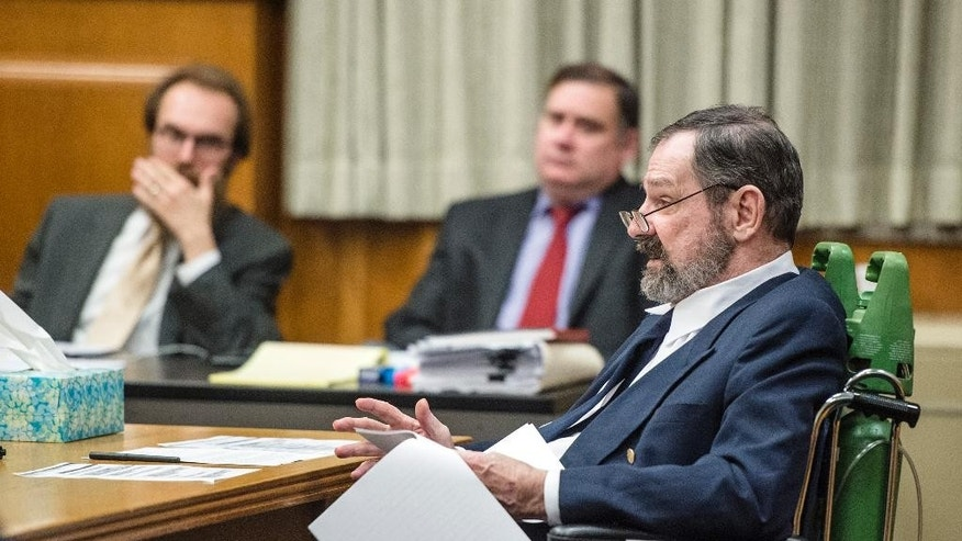 Frazier Glenn Miller Jr., right, asks questions before the jury is brought in during the penalty phase of his murder trial, Tuesday, Sept. 1, 2015, at the Johnson County Courthouse in Olathe, Kan. Jurors, who convicted the white supremacist on Monday of killing three people at Jewish sites in suburban Kansas City in August 2014, will begin hearing more evidence Tuesday before deciding whether to recommend a death sentence. (Allison Long/The Kansas City Star via AP, Pool)