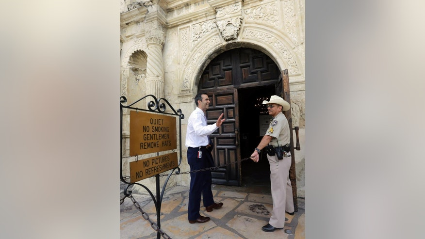 Texas Land Commissioner George P. Bush, left, tours the Alamo following a news conference to celebrate the $31.5 million the General Land Office received for the preservation and development of the Alamo, Wednesday, Sept. 2, 2015, in San Antonio. (AP Photo/Eric Gay)