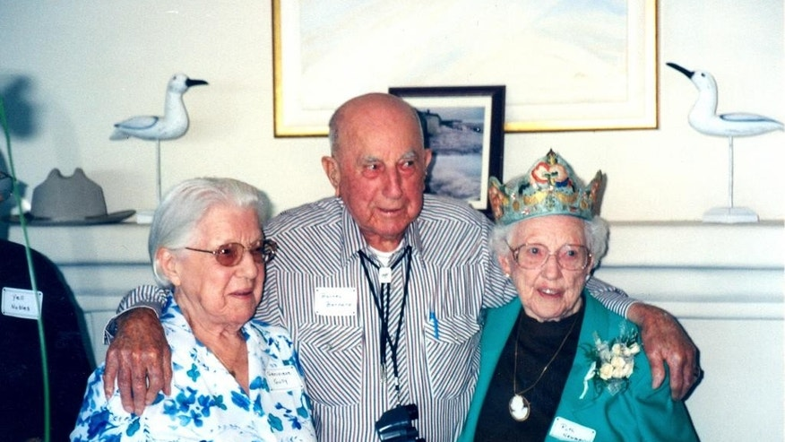 In this Sept. 23, 2001, photo provided by Phil Dobbs, Ruth Newman, right, celebrates her 100th birthday with her older brother Barney Barnard and younger sister Genevieve Gully in Pebble Beach, Calif. Newman, who was thought to be one of two remaining survivors of the massive 1906 San Francisco earthquake, died in July 2015, at the age of 113. (Courtesy of Philip Dodds via AP)