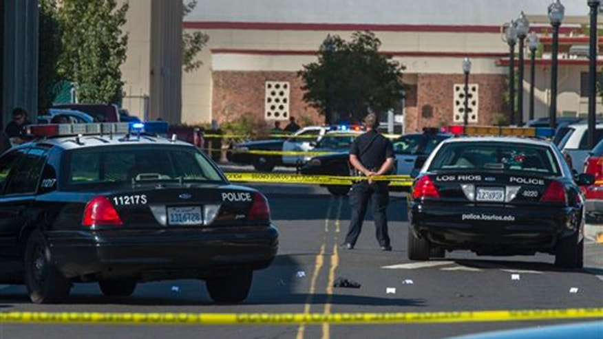 Sept. 3, 2015: A police officer stands guard as Sacramento City College was on lockdown while police search the area after a shooting.