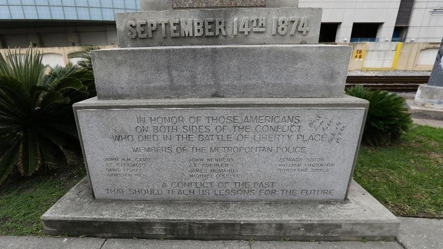 An inscription on a monument refers to the Battle at Liberty Place, in New Orleans, Wednesday, Sept. 2, 2015. Opponents and supporters of a move to remove  prominent Confederate monuments are preparing to speak out over the fate of the monument in the French Quarter, dedicated to a violent uprising against a Reconstruction-era government. The fate of the monument is being discussed by a commission that oversees the French Quarter. (AP Photo/Gerald Herbert)