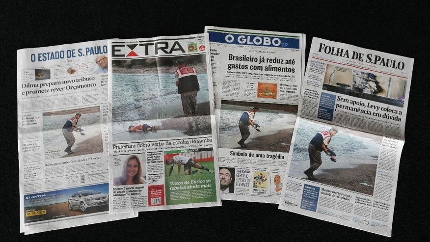 Photos of 3-year-old Syrian boy Aylan Kurdi found dead on a Turkish beach are displayed on the front pages of Brazilian newspapers, in Rio de Janeiro, Brazil, Thursday, Sept. 3, 2015. The photo of the body washed up on the sand was splashed on the front of all major newspapers in Brazil, a nation with more homicides than any other, according to the United Nations. Still, the picture ignited despair and indignation. (AP Photo/Silvia Izquierdo)
