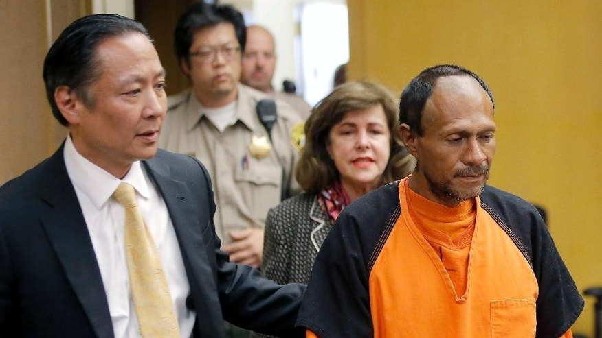 """FILE - In this July 7, 2015 file photo, Juan Francisco Lopez-Sanchez, right, is lead into the courtroom by San Francisco Public Defender Jeff Adachi, left, and Assistant District Attorney Diana Garciaor, center, for his arraignment at the Hall of Justice in San Francisco. The parents of Kathryn Steinle filed a wrongful death claim Tuesday, Sept. 1, 2015 alleging that the San Francisco Sheriff's Department is to blame for releasing an illegal immigrant from jail despite a federal """"detainer"""" request to keep in custody for possible deportation proceedings. A claim is usually a precursor to a lawsuit. (Michael Macor/San Francisco Chronicle via AP, Pool, File)"""