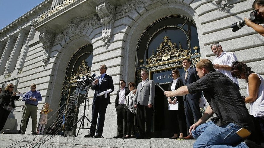 Attorney Frank Pitre, with the family of Kathryn Steinle behind him, speaks during a news conference on the steps of City Hall Tuesday, Sept. 1, 2015, in San Francisco. The parents of the San Francisco woman shot to death by a man being sought for deportation filed legal claims against San Francisco and federal officials in connection with her killing. Kathryn Steinle was shot to death on Pier 14 on July 1 as she walked with her father. (AP Photo/Eric Risberg)