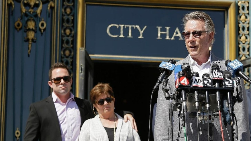 Jim Steinle, right, father of Kathryn Steinle, answers questions during a news conference on the steps of City Hall Tuesday, Sept. 1, 2015, in San Francisco. Listening in the background is Brad Steinle and Liz Sullivan, the brother and mother of Kathryn Steinle. The parents of the San Francisco woman shot to death by a man being sought for deportation filed legal claims against San Francisco and federal officials in connection with her killing.  Kathryn Steinle was shot to death on Pier 14 on July 1 as she walked with her father. (AP Photo/Eric Risberg)