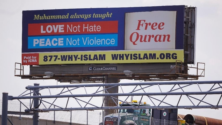 In this Monday, Aug. 31, 2015 photo a billboard proclaims the teachings of Islam near the Massachusetts Avenue Exit of I-93 north in Boston. Dozens of billboards with Muslim themes are sprouting nationwide, proclaiming what organizers say is the true message of Islam and its prophet, Muhammad: peace and justice, not extremism and violent jihad. (AP Photo/Stephan Savoia)