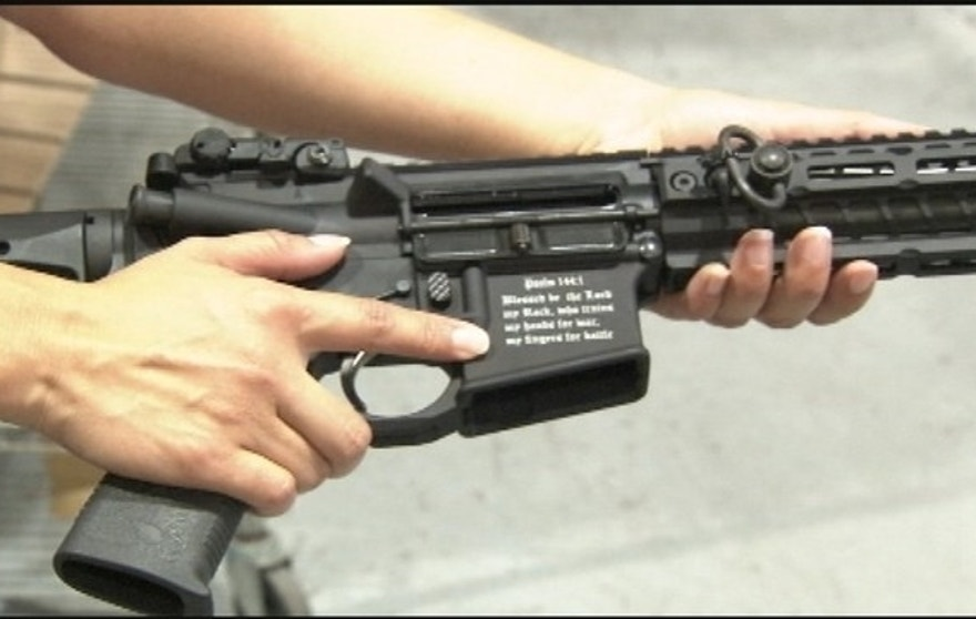 Photo shows Spike's Tactical Crusader etched with a Bible verse.(WOFL-TV)