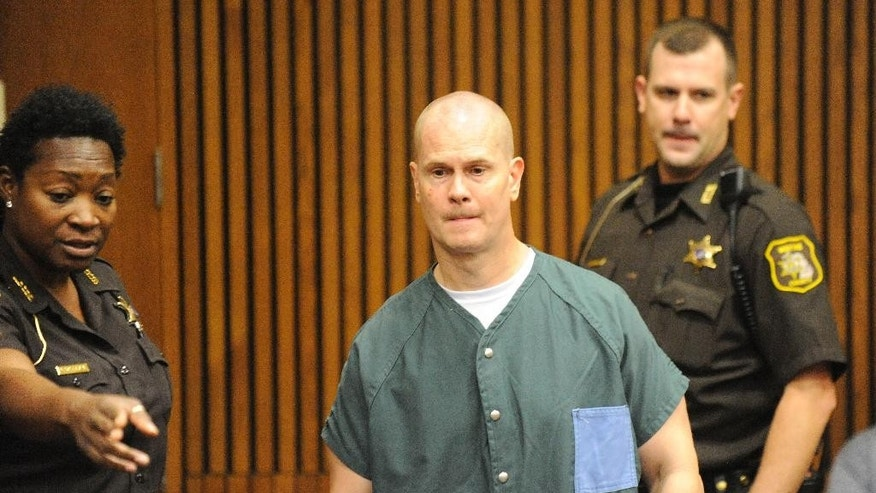 "Rick Wershe Jr. is escorted into a courtroom at Frank Murphy Hall of Justice in Detroit. Friday, Sept. 4, 2015. Wershe, a major Detroit-area drug trafficker known as ""White Boy Rick"" and who has spent nearly 30 years in prison, could soon be released after a judge ordered a resentencing Friday. Wershe Jr., 46, deserves a new sentence because he was sentenced at the age of 18 under old law and the justice system now treats juveniles constitutionally different than adults, Wayne County Circuit Judge Dana Hathaway ruled.(David Coates/Detroit News via AP)  DETROIT FREE PRESS OUT; HUFFINGTON POST OUT; MANDATORY CREDIT"