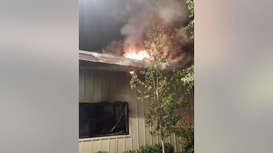 In this image made from a video provided by KREM.com, smoke rises as firefighter try to put out a fire at a Planned Parenthood clinic in Pullman, Wash., Friday, Sept. 4, 2015. The pre-dawn fire heavily damaged the clinic in the college town and a regional terrorism task force is working to determine whether it was arson. (KREM.com via AP) MANDATORY CREDIT