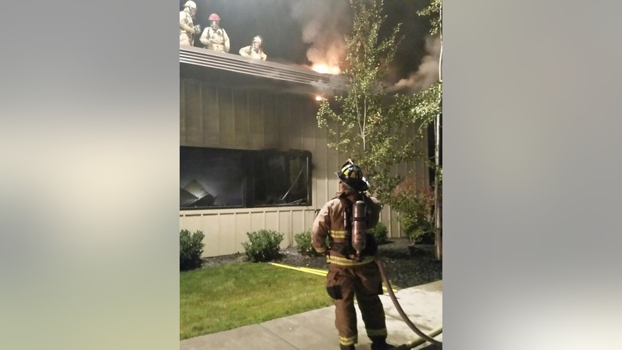 In this image made from a video provided by KREM.com, firefighters try to put out a fire at a Planned Parenthood clinic in Pullman, Wash., Friday, Sept. 4, 2015. The pre-dawn fire heavily damaged the clinic in the college town and a regional terrorism task force is working to determine whether it was arson. (KREM.com via AP) MANDATORY CREDIT