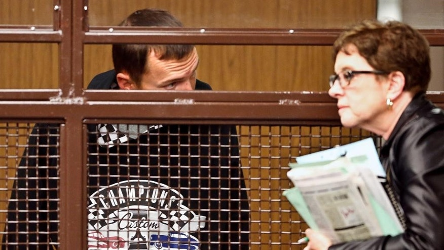 FILE - In this April 25, 2013 file photo, Tobias Dustin Summers, left, talks with his defense attorney Andrea Lemberg during his arraignment at the Los Angeles Superior Court in San Fernando, Calif. A jury is set to deliver its verdict, Friday, Sept. 4, 2015,  against Summers, charged with kidnapping and sexually assaulting a 10-year-old girl in Los Angeles before releasing her and fleeing to Mexico in March, 2013. (Mel Melcon/Los Angeles Times via AP, Pool)