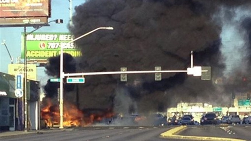 Sept. 5, 2015: Smoke filled the sky after a fire tore through a mini bus following a collision in Las Vegas.