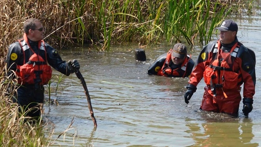 Sept. 6, 2015: Chicago Police Marine Unit divers search a lagoon at Garfield Park, in Chicago, where a toddler's decomposed head, feet and hand were found.