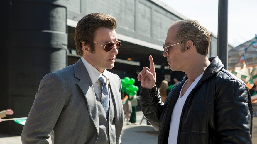 "In this image released by Warner Bros. Entertainment, Joel Edgerton portrays John Connolly, left, and Johnny Depp portrays Whitey Bulger in the Boston-set film, ""Black Mass."" (Claire Folger/Warner Bros. Entertainment via AP)"