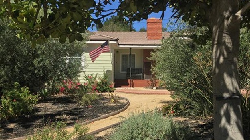 Sept. 7, 2015: A home is shown, Monday, Sept. 7, 2015, in the Los Angeles suburb of La Canada-Flintridge, Calif., where on Sunday night, firefighter James M. Taylor fatally shot his wife, Cecilia Hoschet, herself a deputy with the Los Angeles County Sheriff's Department, before later killing himself at a county fire station.
