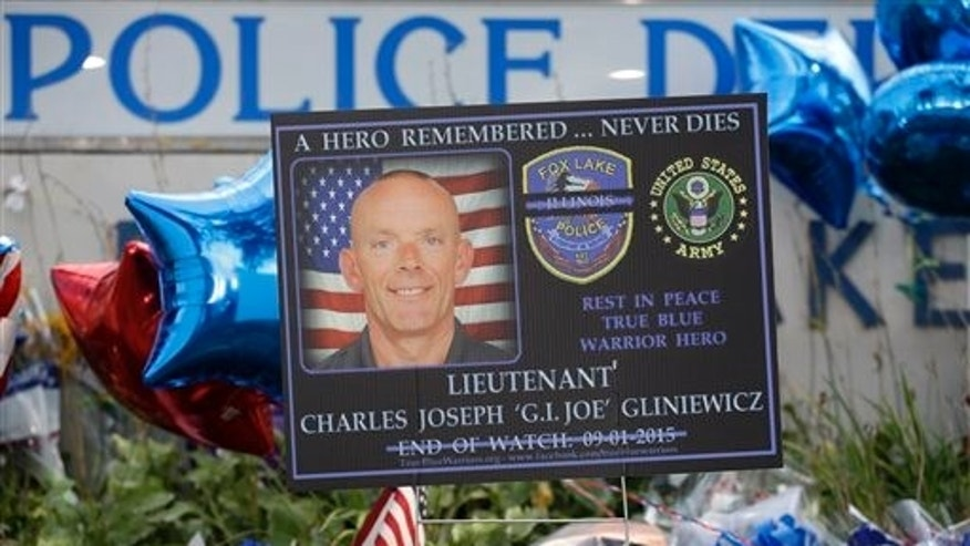 A memorial is in place at the Fox Lake Police Department on Wednesday, Sept. 2, 2015, in Fox Lake, Ill. for murdered officer, Lt. Charles Joseph Gliniewicz. (AP Photo/Nam Y. Huh)