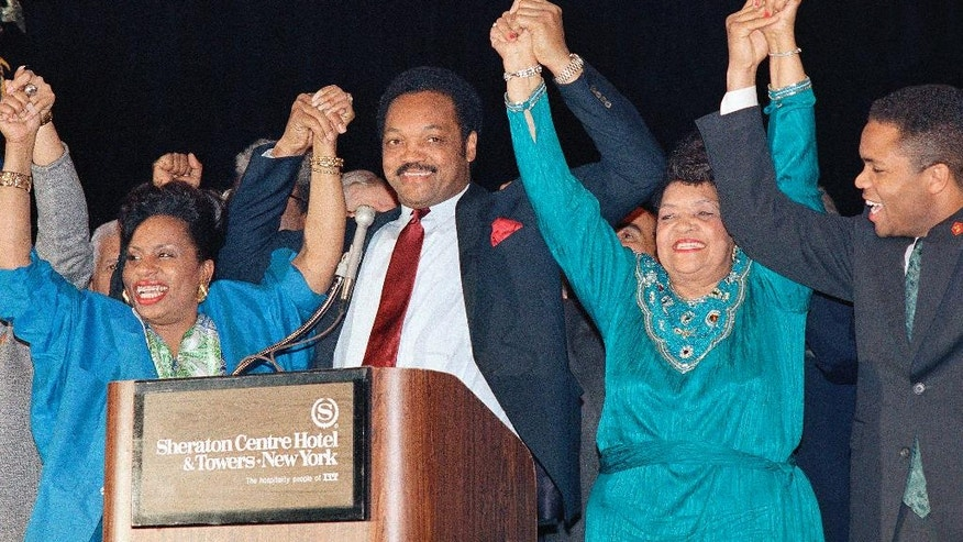 FILE - This April 19, 1988 file photo shows the Rev. Jesse Jackson joining hands with his family, from left, wife Jackie, mother Helen, and son Jesse Jr. before a crowd of supporters at New York's Sheraton Centre Hotel. Jackson told The Associated Press his mother died Monday, Sept. 7, 2015 in her longtime hometown of Greenville, S.C. He says she had been in failing health for some time. She was 92. (AP Photo/David Bookstaver, file)