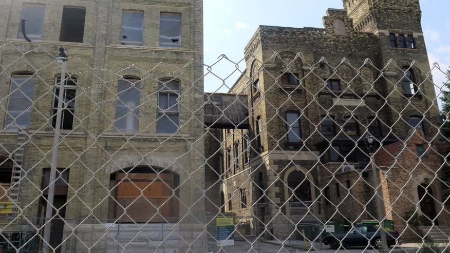 This Sept. 3, 2015 photo shows the former Pabst bottling plant, both built with Cream City bricks, under renovation in Milawukee. The left building, with cleaned bricks, shows a prized find for developers inclined to clear away decades dark stain from buildings revealing  Milwaukee's once-forgotten signature. (AP Photo/Greg Moore)