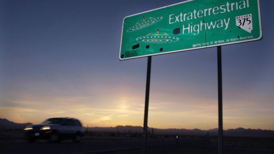 "FILE - In this April 10, 2002, file photo, a car moves along the Extraterrestrial Highway near Rachel, Nev, the closest town to Area 51. The U.S. Air Force is giving an ultimatum to owners of the remote Nevada property: Take a $5.2 million ""last best offer"" by Thursday,, Sept. 10, 2015, for their property now surrounded by a vast bombing range including the super-secret Area 51, or the government will seize it. (AP Photo/Laura Rauch, File)"