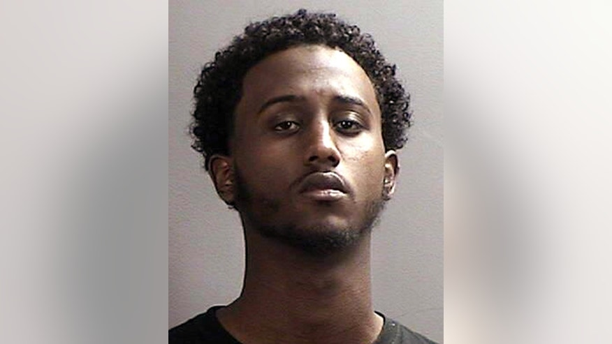FILE - This file photo provided April 21, 2015 by the Sherburne County, Minnesota, Sheriff's Office shows Hanad Mustafe Musse, 19.  Musse is among seven Minnesota men of Somali descent that have been charged in a indictment  with traveling or attempting to travel to Syria to join the Islamic State group, which has carried out a host of attacks including beheading Americans. (Sherburne County Sheriff's Office via AP, File)