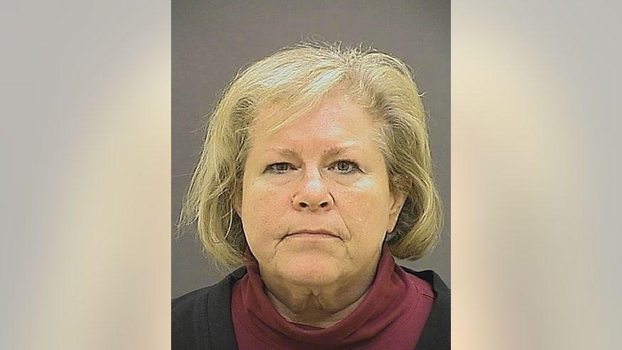 FILE - This undated file photo provided by the Baltimore Police Department shows former Episcopal Bishop Heather Cook. Cook pleaded guilty Tuesday, Sept. 8, 2015, to manslaughter, drunken driving and leaving the scene at which she killed a cyclist. Under an agreement with prosecutors, the state of Maryland will ask a Baltimore Circuit Court judge next month to sentence Cook to 10 years in prison. (Baltimore Police Department via AP, File)