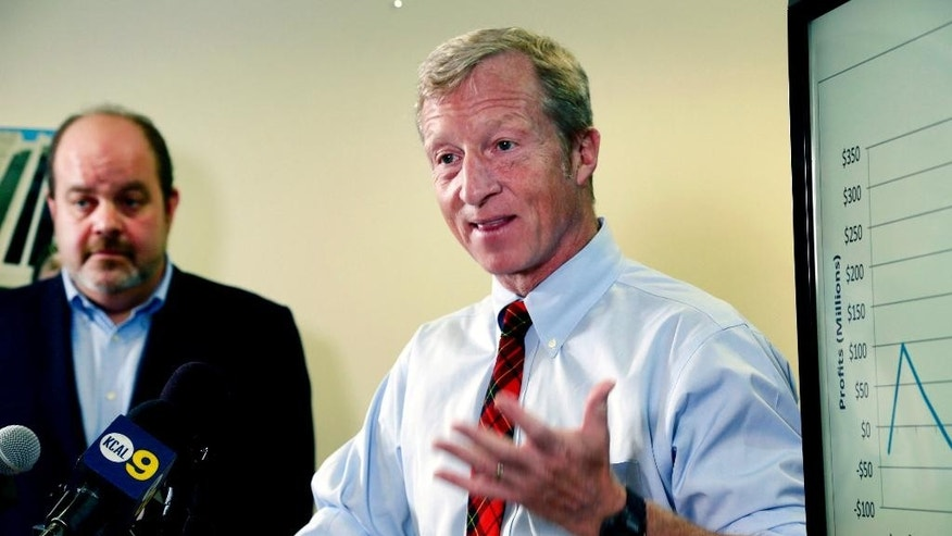FILE - In this Aug. 5, 2015, file photo, billionaire climate activist Tom Steyer, right, speaks during a news conference with consumer advocate Jamie Court, left, president of Consumer Watchdog in Santa Monica, Calif. The Proposition 39 Citizens Oversight Board, tasked with overseeing projects funded by a California ballot measure intended to generate clean-energy jobs, is meeting for the first time on Tuesday, Sept. 8, 2015. (AP Photo/Nick Ut, File)