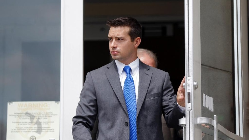 Former Madison, Ala., police officer Eric Sloan Parker walks out of the federal courthouse, Wednesday, Sept. 9, 2015, in Huntsville, Ala. Parker, accused of using excessive force against an Indian grandfather who testified he didn't understand commands given in English, says the man reached in his pockets and defied his orders. Parker took the stand in his own defense Wednesday in his federal trial. (AP Photo/Brynn Anderson)