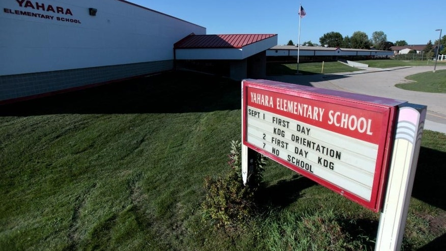This Wednesday, Sept. 9, 2015 photo shows the Yahara Elementary School in DeForest, Wis. A Wisconsin school district says police have found nothing as they search an elementary school where someone reported a man with a gun. (Michael P. King/Wisconsin State Journal via AP) MANDATORY CREDIT