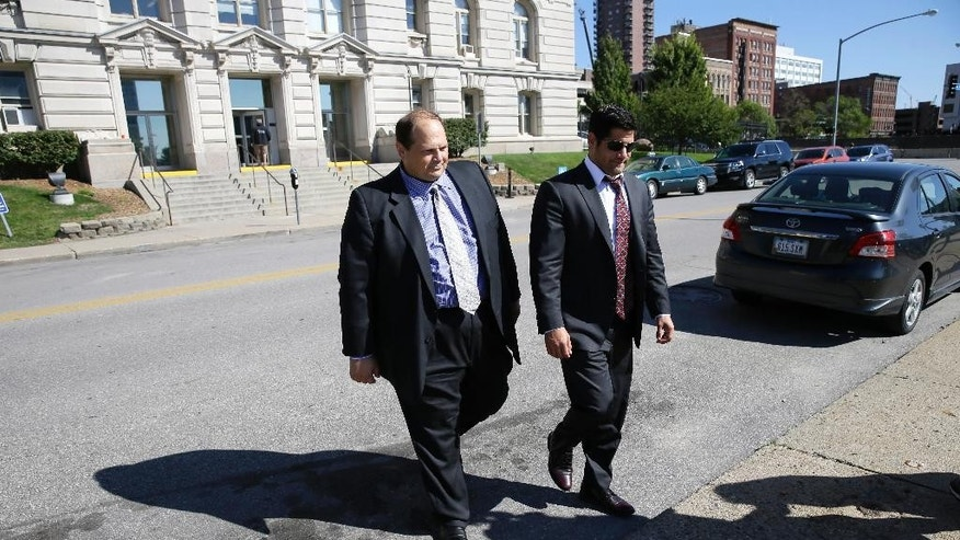 Former lottery security officer Eddie Tipton, left, leaves the Polk County Courthouse with his attorney Nicholas Sarcone after sentencing, Wednesday, Sept. 9, 2015, in Des Moines, Iowa. Tipton was sentenced to 10 years after a jury found he fixed the hot Lotto game in 2010 to get himself a winning ticket for a $14 million jackpot and then attempted to cash it anonymously. (AP Photo/Charlie Neibergall)