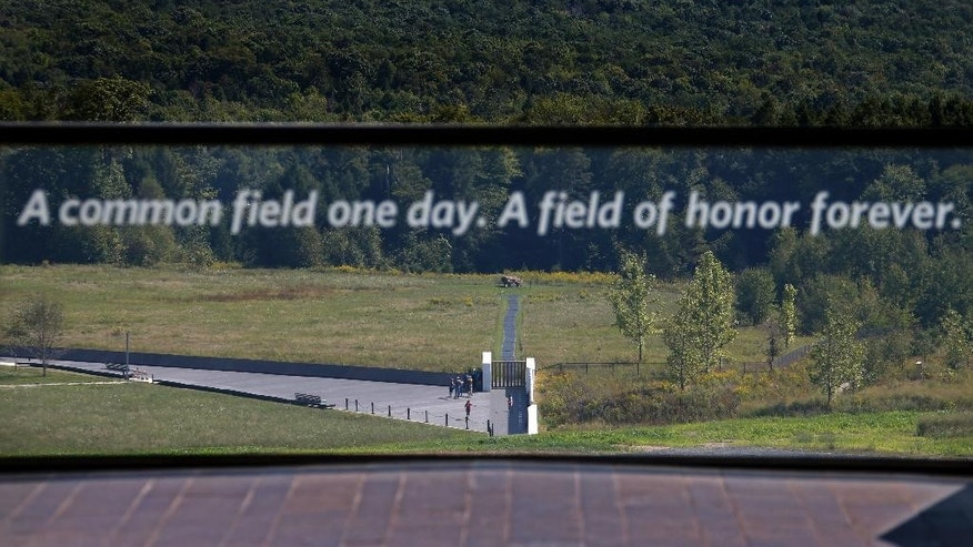 This is the view of the United Flight 93 crash site from the Flight 93 National Memorial's new Visitors center complex in Shanksville, Pa, on Wednesday, Sept. 9, 2015. The boulder, center rear, marks them plane's impact site. The visitors center will be formally dedicated and open to the public on Sept. 10, 2015. (AP Photo/Gene J. Puskar)