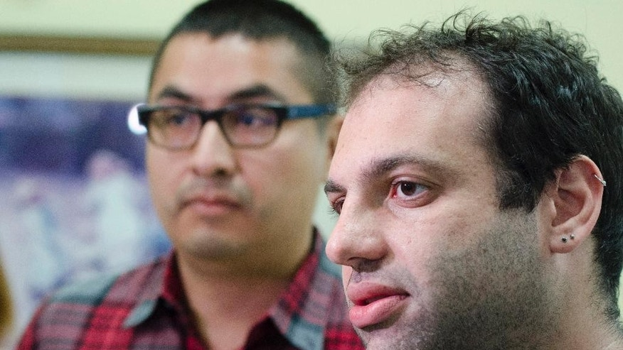 Allen Corona, 34, left, and Mark Shrayber, 32, from San Fransisco, talk to the media after being issued a marriage license in by deputy clerks at the Rowan County Clerk's office Wednesday September 9, 2015 in Morehead, Ky. Deputy clerk Brian Mason says the office will issues licenses Wednesday in Davis' absence if anyone seeks them. Lawyers for Rowan County clerk Kim Davis say she will return to work Friday or Monday. (AP Photo by John Flavell)