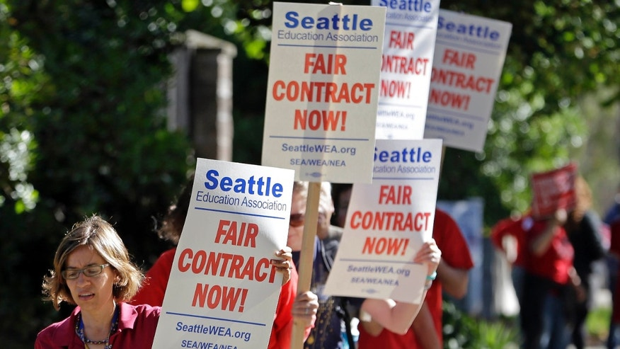 SEpt. 2, 2015: About 50 teachers picket and chant as they picket outside West Seattle High School in Seattle.