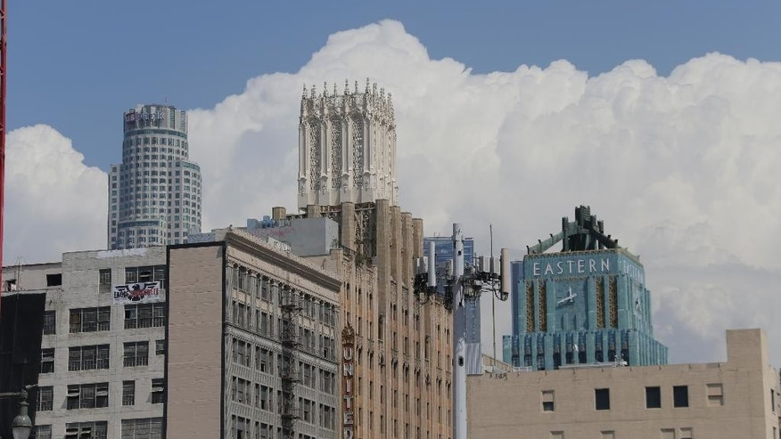 Thunderhead cloud formations are seen over downtown Los Angeles Wednesday, Sept.  9, 2015. Southern California will see dangerously high temperatures this week and a chance of thunderstorms and flooding in the mountains as a building high-pressure system delivers a late-summer scorching, forecasters said Tuesday. (AP Photo/Nick Ut)