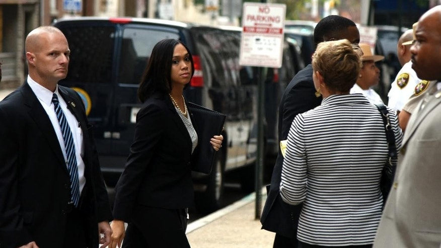Baltimore State Attorney Marilyn Mosby walks into a side door of the Baltimore Circuit Court on Thursday, Sept. 10, 2015 in Baltimore.  The trials for six police officers charged in the arrest and death of Freddie Gray will be held in Baltimore, Circuit Court Judge Barry Williams ruled, saying it would be nearly impossible to find a place not inundated by publicity about the high-profile.  (Barbara Haddock Taylor/The Baltimore Sun via AP)  WASHINGTON EXAMINER OUT; MANDATORY CREDIT