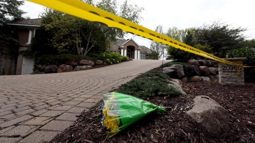 Flowers rest outside the Short family's house in Greenwood, Minn., Friday, Sept. 11, 2015. Police pushed ahead Friday with their investigation into an apparent murder-suicide in the affluent Minneapolis suburb that left the Short family of five dead, while a high school offered counseling to classmates of the three children. (Jim Gehrz/Star Tribune via AP)  MANDATORY CREDIT; ST. PAUL PIONEER PRESS OUT; MAGAZINES OUT; TWIN CITIES LOCAL TELEVISION OUT