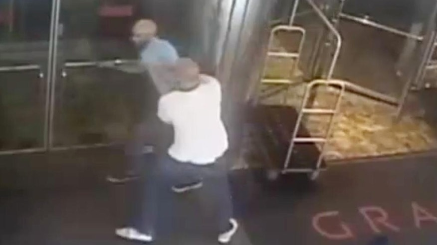 "This image taken from a surveillance camera and released by the New York Police Department shows former tennis star James Blake, top left, being arrested by plainclothes officer James Frascatore outside of the Grand Hyatt New York hotel on Wednesday, Sept. 9, 2015, in New York. Blake was mistaken for an identity-theft suspect that Police Commissioner William Bratton said looked like Blake's ""twin."" Bratton apologized to Blake. (NYPD via AP) NO SALES"