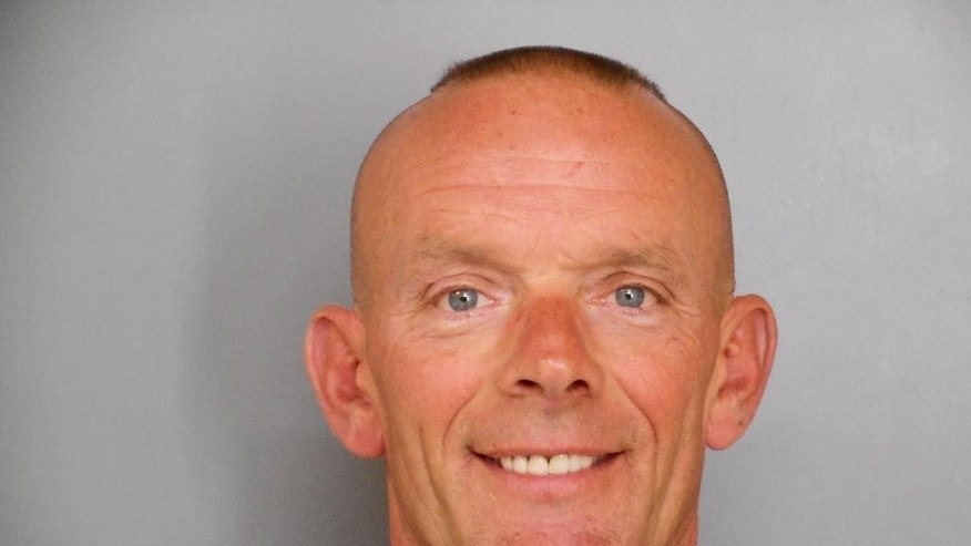 FILE -  This undated file photo provided by the Fox Lake Police Department shows Lt. Charles Joseph Gliniewicz, was shot and died Tuesday, Sept. 1, 2015, in Fox Lake, Ill. More than a week after the shooting death of Fox Lake Police officer  Lt. Charles Joseph Gliniewicz sparked a manhunt for three suspects and a national outpouring of grief, investigators who have not identified a suspect are lashing out at a county coroner who they say is jeopardizing their investigation. (Fox Lake Police Department photo via AP, File)