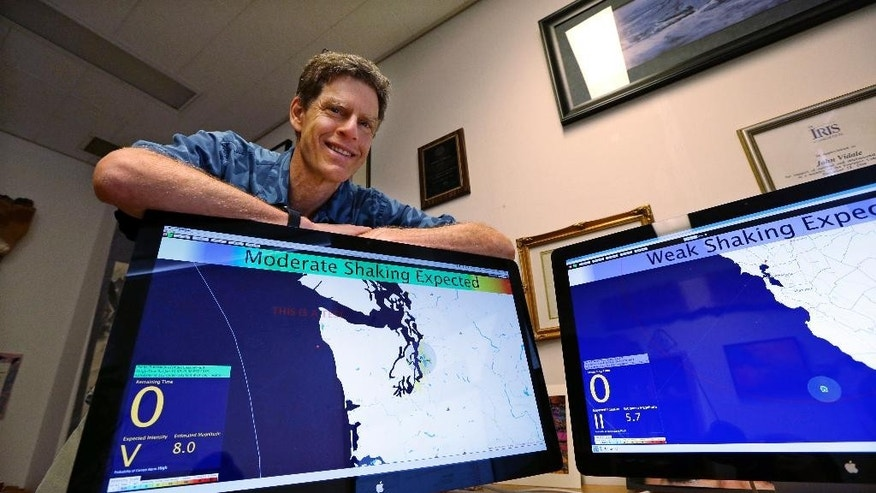 In this photo taken Thursday, Aug. 6, 2015, John Vidale, director of the Pacific Northwest Seismic Network at the University of Washington, displays a beta version of an early warning system for earthquakes, in Seattle. When North America's undersea edge and a tectonic plate pushing beneath it inevitably give way to three centuries of accumulated stress, unleashing a monster earthquake and tsunami in the Pacific Northwest, the expected catastrophic loss of life and economic disruptions could be lessened by such an early warning system. (AP Photo/Elaine Thompson)