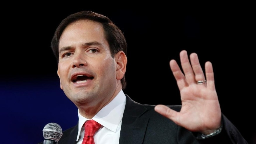 FILE - In this Aug. 22, 2015 file photo, Republican presidential candidate, Sen. Marco Rubio, R-Fla., speaks in Columbus. To some Republican presidential candidates, it's better to be with the popular pope than against him.  (AP Photo/Paul Vernon, File)