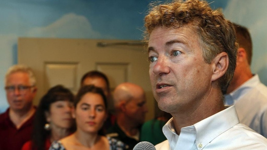 FILE - In this Sept. 2, 2015 file photo, Republican presidential candidate Sen. Rand Paul, R-Ky. speaks in Manchester, N.H. To some Republican presidential candidates, it's better to be with the popular pope than against him. (AP Photo/Jim Cole, File)