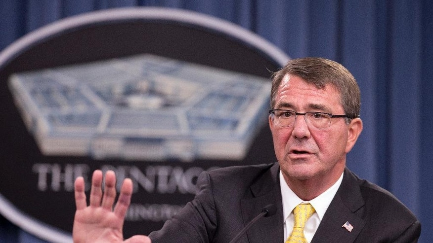 "FILE - In this Aug. 20, 2015 file photo, Defense Secretary Ash Carter speaks during a news conference at the Pentagon. The Obama Administration's struggling crusade to close the U.S. detention center at Guantanamo Bay, Cuba, is mired in state and federal politics, and frustrated White House and Pentagon officials are blaming each other for the slow progress releasing approved detainees and finding a new prison to house the remainder.""  (AP Photo/Manuel Balce Ceneta, File)"