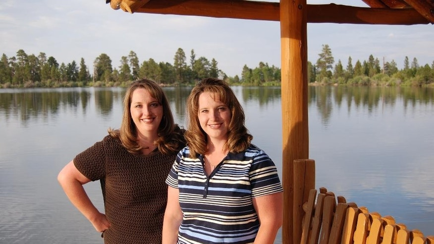 """Twin sisters Kelli Wall, left, and Kerri Bunker are shown in this undated photo provided by Kerri Bunker. The two women are identical twins who already each have one set of twins. Now, they are getting ready to each have a second set of twins next spring, KSL-TV reports. """"To have twins twice is incredible,"""" Wall said. The Lindon women both had their first set of fraternal twins after using in vitro fertilization after they struggled to get pregnant. This summer, both found out they are having twins again. They are both due two weeks apart next spring.  (Kerri Bunker via AP)"""