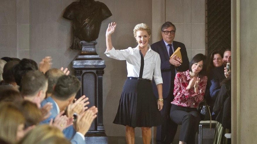 Fashion designer Carolina Herrera waves to applause after showing her Spring 2016 collection during Fashion Week on Monday, Sept. 14, 2015, in New York. (AP Photo/Bebeto Matthews)