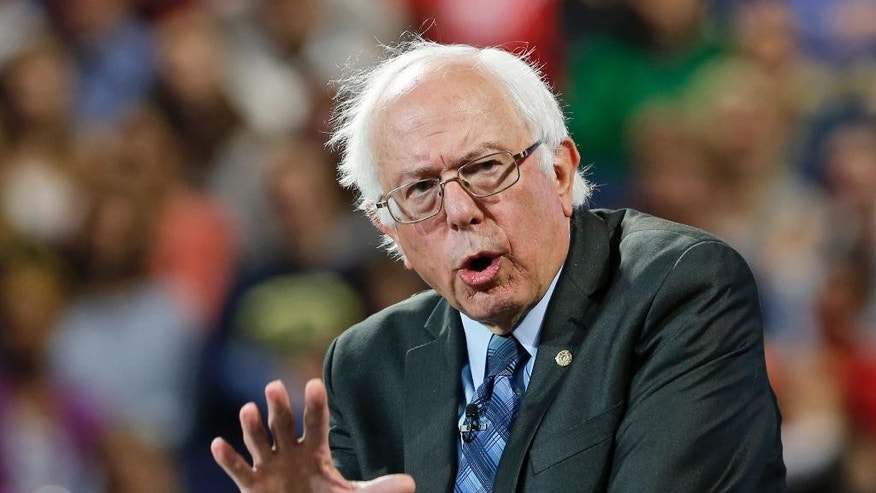 Democratic presidential candidate, Sen. Bernie Sanders, I-Vt. gestures during a speech at Liberty University in Lynchburg, Va., Monday, Sept. 14, 2015. (AP Photo/Steve Helber)