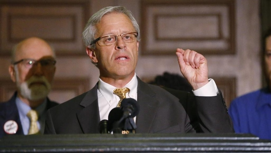 Don Knight, one of the defense attorneys for Richard Glossip, gestures as he speaks during a news conference in Oklahoma City, Monday, Sept. 14, 2015. Glossip is scheduled to be executed on Wednesday, Sept. 16, 2015, and his defense team is asking for a stay while they search for evidence in the case. (AP Photo/Sue Ogrocki)