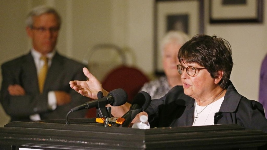 Sister Helen Prejean, a death penalty opponent, speaks during a news conference in Oklahoma City, Monday, Sept. 14, 2015. Looking on at left is Don Knight, one of the defense attorneys for Richard Glossip.  Glossip is scheduled to be executed on Wednesday, Sept. 16, 2015, and his defense team is asking for a stay while they search for evidence in the case. (AP Photo/Sue Ogrocki)