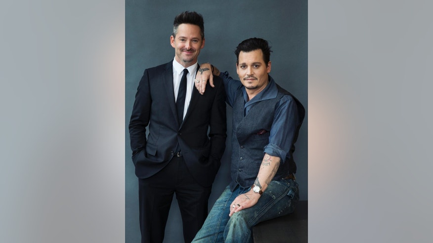 "Director, Scott Cooper, and actor, Johnny Depp pose for a portrait in promotion of their upcoming film ""Black Mask"" at the 2015 Toronto International Film Festival on Sunday, Sept. 13, 2015 in Toronto. (Photo by Victoria Will/Invision/AP)"